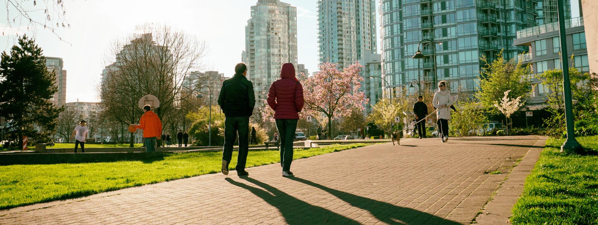 Couple walking through Yaletown, Vancouver