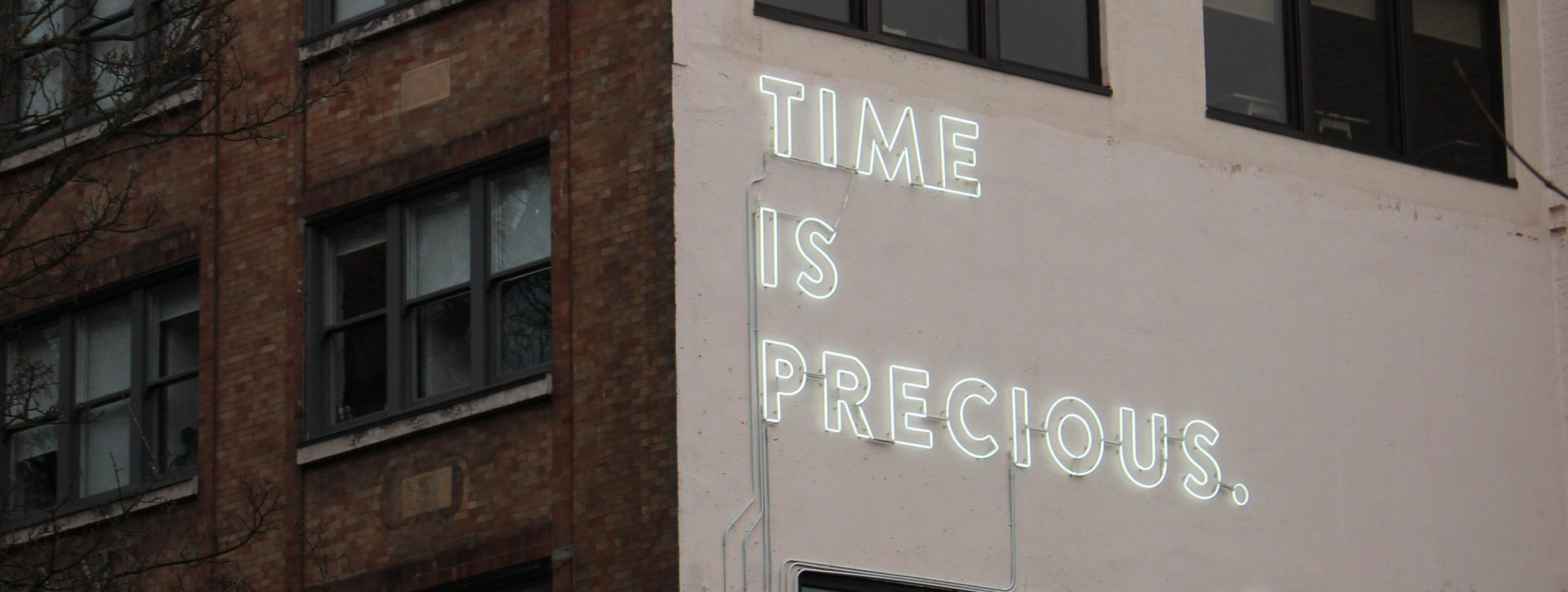 """Time is Precious"" sign in Yaletown, Vancouver"